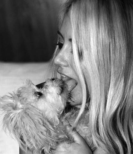 Crazy chick licking her dog